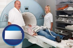 kansas a magnetic resonance imaging machine with a technician, nurse, and patient