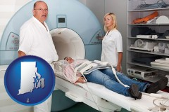 rhode-island a magnetic resonance imaging machine with a technician, nurse, and patient
