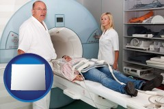 wyoming a magnetic resonance imaging machine with a technician, nurse, and patient