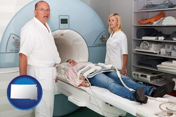 a magnetic resonance imaging machine with a technician, nurse, and patient - with South Dakota icon